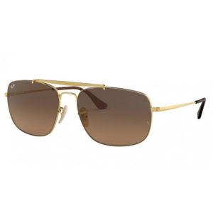 Occhiali RayBan RB3560-910443 montatura colre oro, lente marrone sfumato e forma rettangolare. Lente: 61,58mm Ponte: 17mm Asta: 145mm